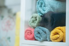 Colorful bath towels pile in sore showroom. Closeup of colorful bath towels pile in sore showroom Stock Photos