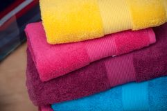 Colorful bath towels pile in store. Closeup of colorful bath towels pile in store Stock Photo