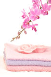 Colorful bathroom set with towels and orchid. A decorative bathroom set with three towels, two rose petal shaped pieces of soap and a pink orchid Royalty Free Stock Images
