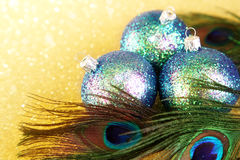 Colorful baubles. With peacock feathers Royalty Free Stock Photos