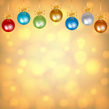 Colorful baubles on golden background. Christmas card with colorful baubles on golden background Royalty Free Stock Photo