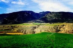 Colorful BC Interior Plateau. I love the contrast between the mountains, desert plateau, and alfalfa fields in this colorful image I captured in British Columbia Royalty Free Stock Photography