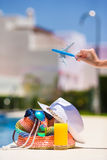 Colorful beach bag, glass of juice, straw hat and Royalty Free Stock Images