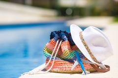 Colorful beach bag, straw hat and airplane model Stock Photo