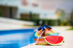 Colorful beach bag and tasty red watermelon at Stock Image