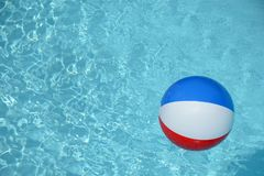 Colorful beach ball in pool royalty free stock photo