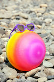 Colorful beach ball with sunglasses Stock Images