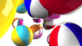 Colorful beach balls on white background.