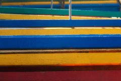 Colorful beach benches stacked in a pile, close-up. Abstract background, geometry royalty free stock photos