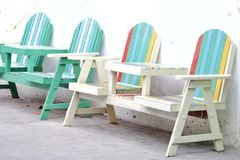 Colorful beach benches on white wall background in outdoor place. Colorful beach benches white wall background outdoor place architecture sit seat chair nobody royalty free stock photos