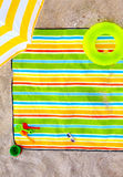 Colorful beach blanket with kid items Stock Image