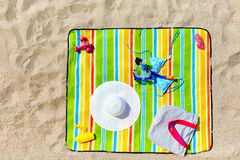 Colorful beach blanket with woman items Stock Images
