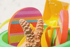 Colorful beach bucket Stock Photos