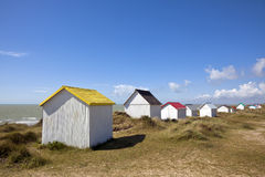 Colorful beach cabins at Gouville-Sur-Mer, Normandy. Beach cabins in the dunes of Gouville-Sur-Mer at the western coast of Cotentin peninsula, Manche region Royalty Free Stock Photography