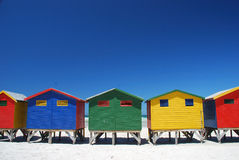 Colorful beach cabins in Muizenberg, South Africa. Brightly colorful beach cabins in Muizenberg, Western Cape, South Africa Royalty Free Stock Image