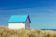Colorful beach cabins, Normandy, France. Colorful wooden beach cabins in the dunes, Gouville-sur-Mer, Normandy, France stock images