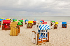 Colorful beach chairs Stock Images