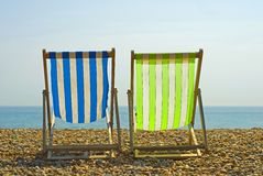 Colorful beach chairs stock photos