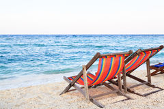 Colorful beach chairs on the beach Stock Photos
