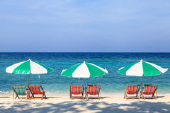 Beach chairs and umbrellas on the beach Royalty Free Stock Images