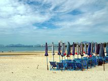 Colorful beach chairs and umbrellas with blue sky Royalty Free Stock Image