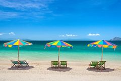 Colorful beach chairs with umbrellas on a sunny day. Thailand stock images