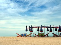 Colorful beach chairs and umbrellas for tourism relax in vocation. Colorful beach chairs and umbrellas with blue sky for tourism relax in vocation at Cha-Am Stock Photography