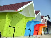 Colorful beach chalets by seaside Royalty Free Stock Images