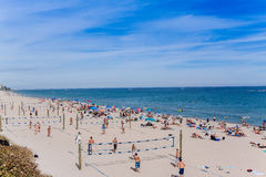Colorful beach crowded with people and umbrellas. Royalty Free Stock Photos