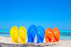 Free Colorful Beach Flip Flops Sandals On The Beach Royalty Free Stock Photography - 53003767