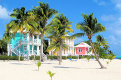 Colorful beach houses. Relaxing beautiful home on the beach on remote island of Little Cayman in the Caribbean Stock Photo