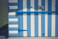 Colorful beach hut with blue and whiter stripes Stock Photography