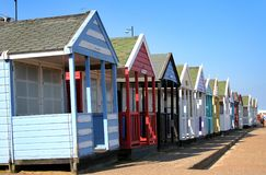 Colorful Beach Huts. A Row of colorful Beach Huts on the Promenade of a Coastal resort in England Royalty Free Stock Photo