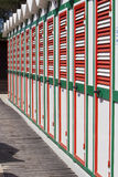 Colorful beach huts. Cabins one strand colored green white red Stock Photos