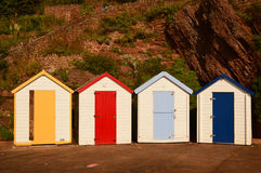 Colorful Beach Huts at Goodrington Devon. Colorful Beach Huts in Goodrington, Devon, England, yellow, red, light blue, blue doors Stock Images