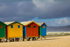 Colorful beach huts at Muizenberg Beach. Row of beach huts at Muizenberg beach, Cape Town, South Africa, on sunny winter day Royalty Free Stock Photography