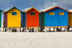 Colorful beach huts at Muizenberg Beach. Row of beach huts at Muizenberg beach, Cape Town, South Africa, on sunny winter day Stock Image
