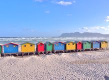 Colorful beach huts at Muizenberg, South Africa. Colorful beach huts at Muizenberg near Cape Town, South Africa. Sea ,Sand and blue sky as background Stock Photo