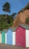 Colorful Beach Huts at Seaton, Devon, UK. A row of colorful beach huts on a sunny day at the coastal town of Seaton, Devon, UK Stock Photography