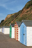 Colorful Beach Huts at Seaton, Devon, UK. A row of colorful beach huts on a sunny day at the coastal town of Seaton, Devon, UK Royalty Free Stock Photography