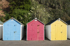 Colorful Beach Huts at Seaton, Devon, UK. A set of three brightly colored beach huts at Seaton, Devon, UK Royalty Free Stock Photo