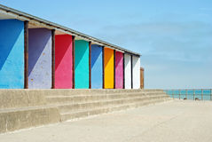 Colorful beach huts with stone steps Royalty Free Stock Photos