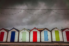 Colorful beach huts on a stormy day Royalty Free Stock Image