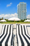 Colorful beach lounge chairs Stock Photo