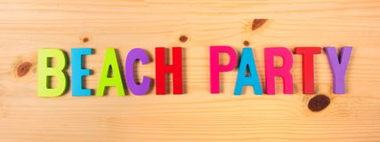 Beach party in text on wood Stock Photo