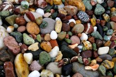 Colorful beach rocks. Details of colorful beach rocks or stones Stock Images