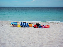 Colorful Beach Towels, Chairs and Balls on White Sand Beach Royalty Free Stock Image