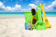 Colorful beach toys in the sand. Some different beach toys and orange sunglasses on the sunny beach stock image