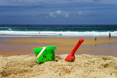 Colorful beach toys on sand. Colorful summer children beach toys on ocean coast in Portugal Stock Photos
