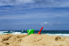 Colorful beach toys on sand. Colorful summer children beach toys on ocean coast in Portugal Royalty Free Stock Image